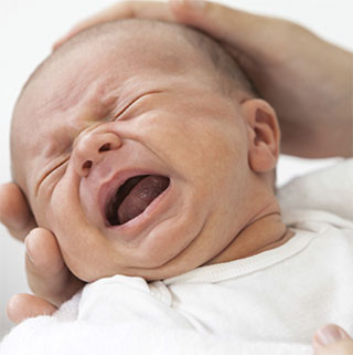 A photo of a baby with colic